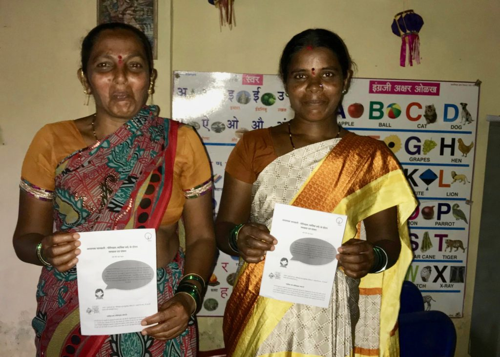 Women from Pali Village learning from SEHER's health brochures
