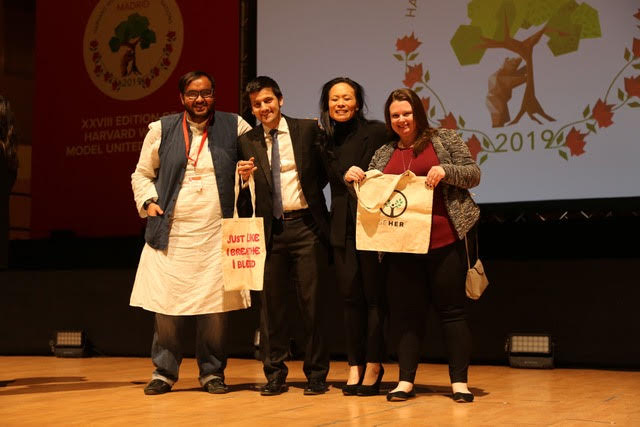 Vedant Shukla and The Resolution Project Team with the SEHER bags at the Harvard WorldMUN in 2019 in Madrid, Spain.