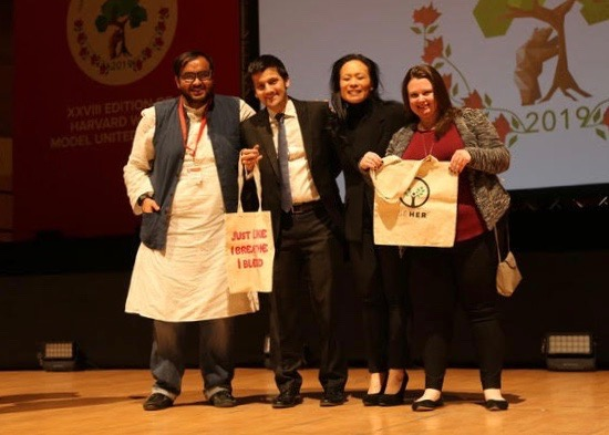 Vedant Shukla and The Resolution Project showing off their SEHER totes at the Harvard WorldMUN in 2019 in Madrid, Spain.